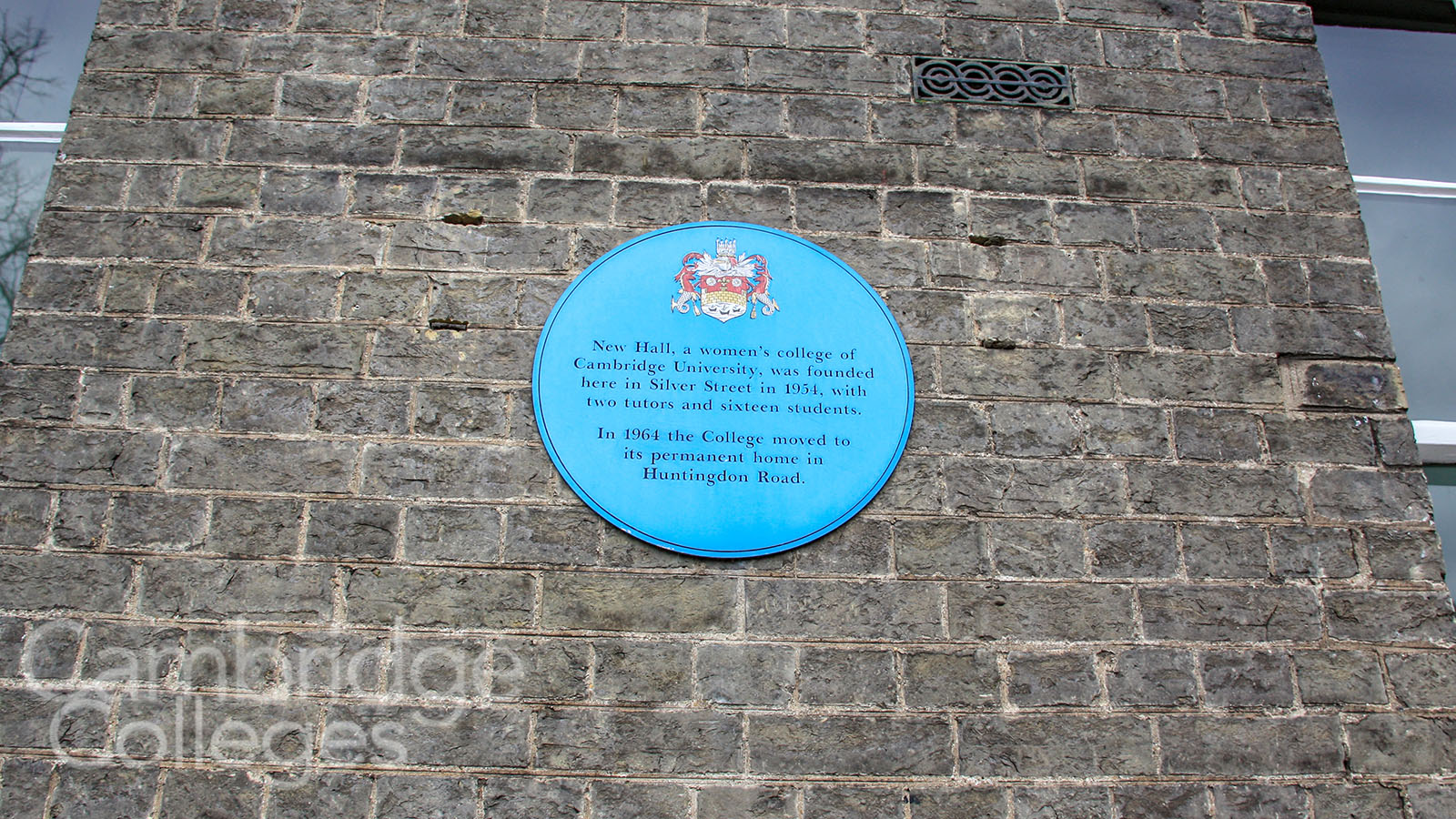 A blue plaque commemorates the original site of New Hall