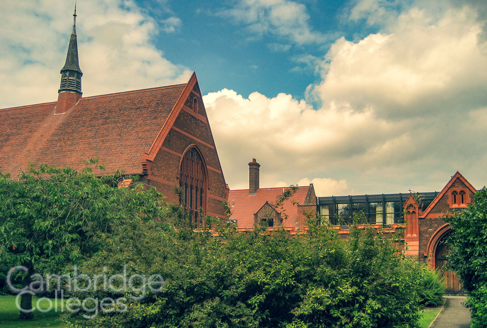 Girton College chapel, partially obscured by trees
